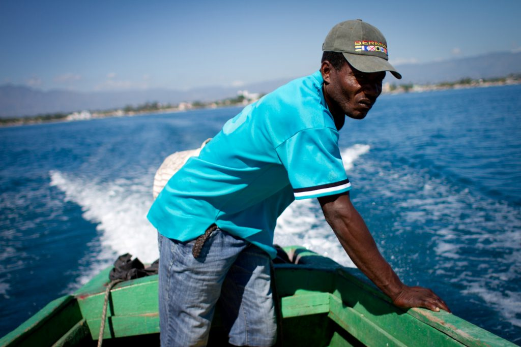 In this December 2014 photo, a man navigates his boat toward an island off Haiti's Southern peninsula -- the area area hardest hit by Hurricane Matthew this month. (Photo by Jacob Kushner and used here with permission)