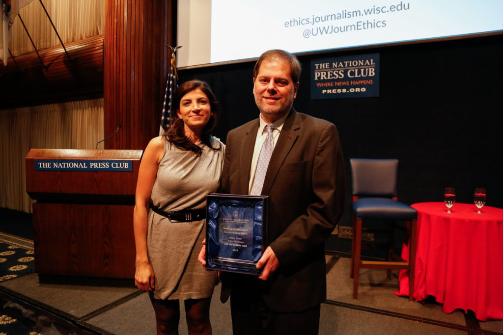 Brian Grow receiving the Shadid Award on behalf of his team in 2018. Shown here with Nada Bakri, Anthony Shadid's widow.