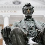 A light snow falls on the Abraham Lincoln statue in front of Bascom Hall at the University of Wisconsin-Madison during winter on Dec. 28, 2015. (Photo by Jeff Miller/UW-Madison)