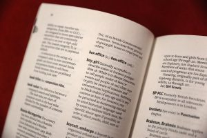 """Photo of AP Stylebook opened to the entry """"boy, girl"""": Coburn Dukehart / Wisconsin Center for Investigative Journalism"""