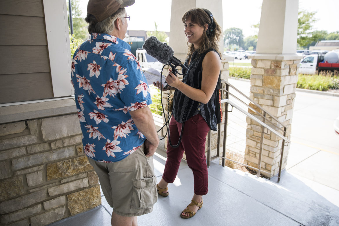 "Wisconsin Center for Investigative Journalism public engagement and marketing assistant Natalie Yahr interviews Bob Blersch on primary day at the Oconomowoc Community Center on August 14, 2018, as part of the Center's ongoing series ""Undemocratic: Secrecy and Power vs. the People."" (Katie Scheidt / Wisconsin Center for Investigative Journalism)"