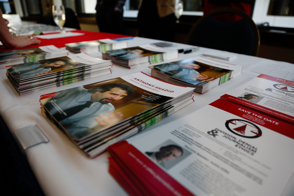 Photo of stack of brochures about the Anthony Shadid Award for Journalism Ethics