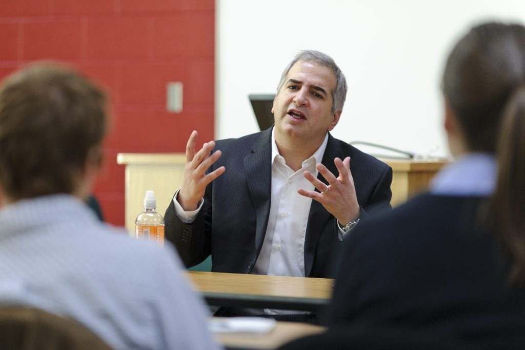 On Dec. 2, 2010, international correspondent for the New York Times Anthony Shadid (center) speaks to a group of journalism students in a Vilas Hall classroom at the University of Wisconsin-Madison. Shadid is a UW-Madison alumnus and two-time Pulitzer Prize winner. (Photo by Bryce Richter / UW-Madison)