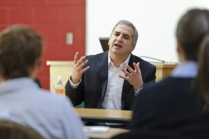 On Dec. 2, 2010, foreign correspondent for the New York Times Anthony Shadid (center) speaks to a group of journalism students in a Vilas Hall classroom at the University of Wisconsin-Madison. Shadid is a UW-Madison alumnus and two-time Pulitzer Prize winner. (Photo by Bryce Richter / UW-Madison)