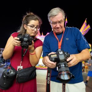 University of Georgia Grady College of Journalism and Mass Communication student Becca Beato works with the Columbus Ledger-EnquirerÕs Mike Haskey during a photojournalism workshop at the Georgia National Fair on Friday, October 5, 2018, in Perry, Georgia. (Photo/Mark E. Johnson, mej@mejphoto.com)