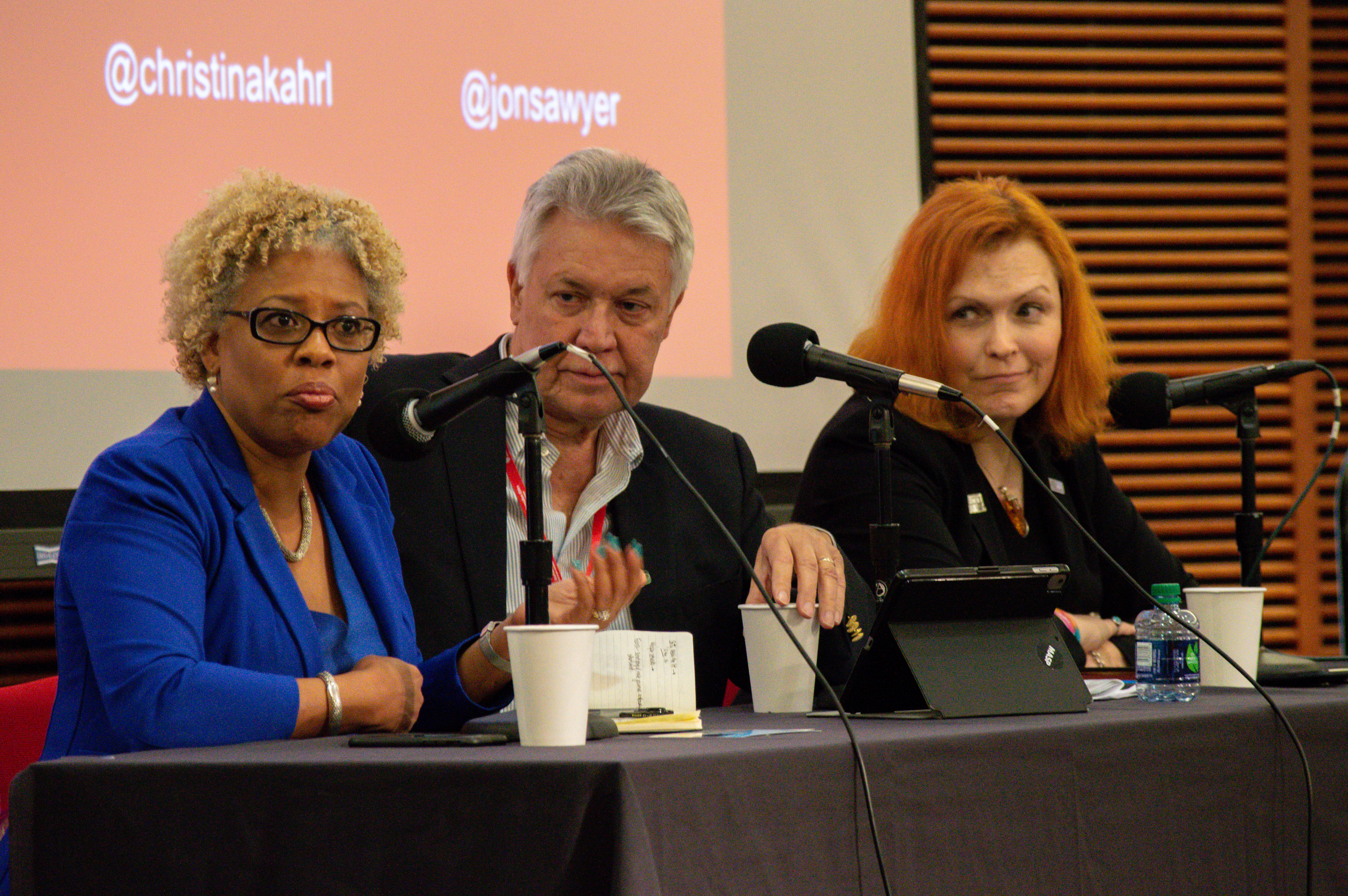 Photo of three panelists at the 2019 journalism ethics conference.