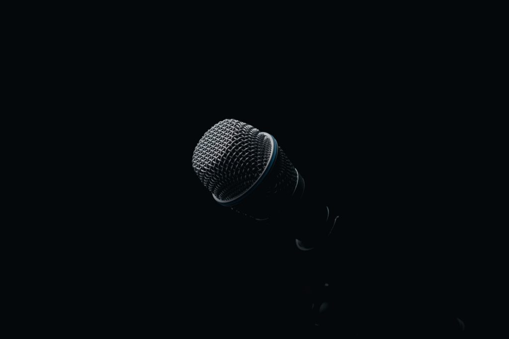 Image of a microphone against a dark backdrop.