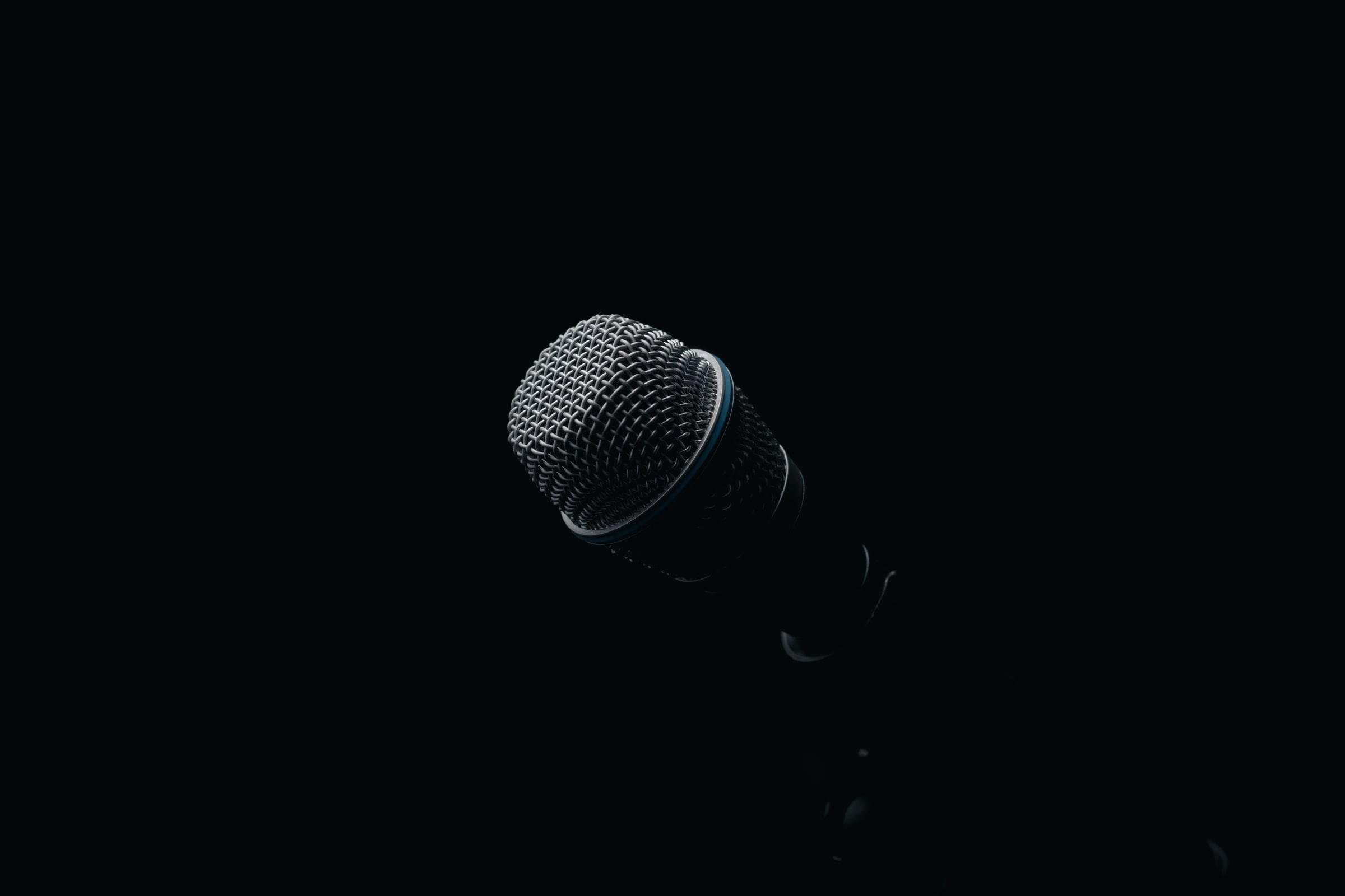 Image of a microphone against a dark backdrop