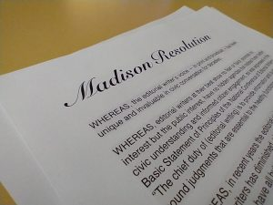 Image of the Madison Resolution lying on a desk.