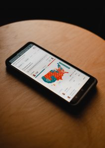 Photo of cell phone on a table that is displaying the New York Times' electoral college map.