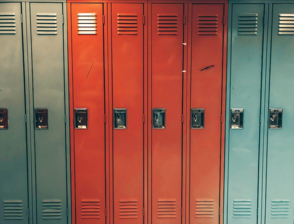 Image of two aqua school lockers, four red lockers and two aqua lockers